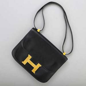 Hermes black constance bag 23 cm black leather gold tone hardware stamped hermes paris with year stamp a in circle for 1971 18 x 23 cm