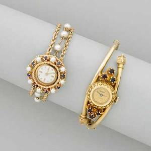 Two victorian style 14k gold bracelet watches 14k yg hinged bypass with garnets swiss mechanical movement 2 13 x 1 34 14k yg pearl and sapphire framed circular quartz watch pearl and rope l