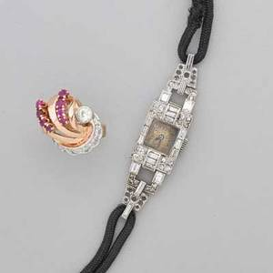 Art deco diamond watch and retro diamond ruby ring dress watch with single and baguette cut diamond bezel and lugs scrolling foliate engraved gallery on black silk cord marked with french hallmarks