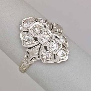 Art deco diamond platinum navette ring pierced and chased set with nine omc diamonds approx 1 cts tw ca 1930 marked 10 iridiumplat size 6 14 26 dwt