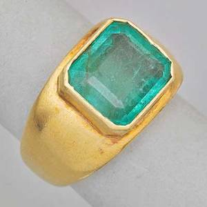 Emerald 18k yellow gold ring rectangular step cut emerald 450 cts by formula in octagonal setting on smooth tapered band 20th c unmarked size 7 78 dwt