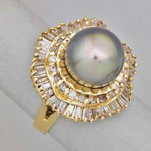 Tahitian pearl and diamond 14k gold ballerina ring eggplant colored black south sea pearl 118 mm and rows of baguette cut and circular cut diamonds ca 1985 unidentified maker mark size 6 34