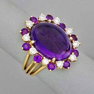 14k yellow gold amethyst and diamond ring steep oval amethyst cabochon 17 x 13 x 973 mm 13 cts by formula surrounded by ten faceted amethysts and ten round brilliant cut diamonds approx 60 c