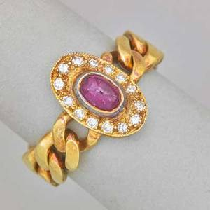 Flexible ruby and diamond 18k yellow gold ring oval ruby cabochon and single cut diamond cluster joins curb link band italy ca 1985 marked italy size 7 46 dwt