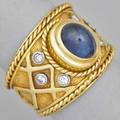 Diamond cabochon sapphire 18k gold lattice ring 18k yg and wg bezel set central steep oval cabochon 25 cts tw throughout diamond accents on shoulders size 9 108 dwt