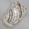 Champagne and colorless diamond ring 14k wg channel set undulating rows white and champagne baguette diamonds outlined by single cut diamonds approx 24 cts tw throughout size 8 48 dwt