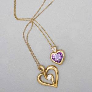 Two 14k yellow gold heart pendants with diamonds bezel set heart shaped amethyst under three stone diamond cluster on 14k yg chain 16 sinuous design centers approx 25 ct round brilliant cut d