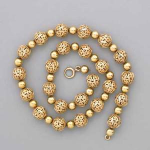14k yellow gold bead necklace spherical filigree beads in scrolling floral design approx 10 mm separated by bright beads 6 mm on gold plated chain ca 1960 marked 14k on spring ring 16 18
