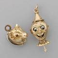 Two gold or goldtopped charms english 10k gold mechanical pinocchio charm enameled tongue and eyes moved by pull pin indistinct english date and maker marks 53 dwt 10k gold topped bull with ru