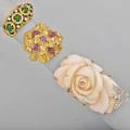 Three gold diamond and gem set rings four emerald cabochons and diamonds size 4  carved angel skin coral white gold diamond butterfly accent size 9 12 18k yg cluster form with fire rubies si