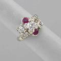 Diamond and ruby 14k white gold cluster ring modified bypass design central transitional cut diamond approx 70 ct two round cut faceted rubies with smaller transitional and oec diamonds approx
