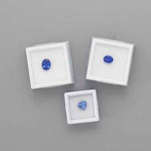 Three unmounted faceted tanzanites oval 275 cts 10 x 8 mm oval 189 cts 89 x 695 mm trillion cut 249 cts 834 x 831 mm 713 cts tw