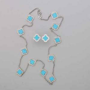 Turquoise diamond 18k gold necklace and earrings 18k wg necklace and matching earrings in alhambra style design clover shaped turquoise disks set within prong set single cut diamond mounts on rolo
