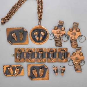 Frank rebaje modernist copper jewelry ten pieces seven pieces brazilian mask patinated suite includes link bracelet 1 34 x 6 34 three brooches largest 2 12 x 2 disc pendant on chain s