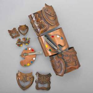 Rebaje copper jewelry ten pieces six tragedy and comedy pieces includes two cuff bracelets 2 wide accommodates 6 12 two brooches largest 2 12 x 2 and a pair of earrings 1 x 1 four