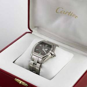 Cartier roadster automatic steel bracelet watch tonneau shaped black dial with luminous hours and hands bubble date aperture at 300 center seconds water resistant 100m ref w62002v3 36 mm