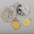 Assorted gold or silver coin jewelry and token four pieces 1912 queen wilhelmina 10 gulden and gold pendant bicolor chinese 10 yuan panda coin pendant 1922 american peace dollar in silver pendant