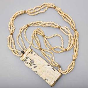 Antique carved ivory jeweled gold necklace delicately pierced carved tablet depicts mother and child at leisure among clouds and blossoms 14k gold mount with diamond and sapphire triple strand rop