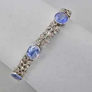Late victorian gemset bracelet six oval faceted blue sapphires approx 15 cts tw in millegrained bezels joined by leafy links set with rose cut diamonds silvertopped gold 6 12 118 dwt