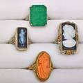 Four art deco carved hardstone 14k gold rings two wg filigree rings with rectangular hardstone cameos rectangular engraved chrysoprase and wg coral cameo in yg sizes 4 12  6 12 98 dwt