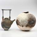 Tom neugebauer rakufired teapot with forgediron handle and large spherical vase 1978 both signed vase dated taller with handle 14 12