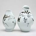 Jean cocteau rosenthal pair of porcelain vases decorated with faces germany 1953 signed and dated taller 9 34