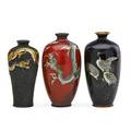 Japanese cloisonne vases three early 20th c red with dragons black with three cranes and enameled overlay dragon on wire ground tallest 4 34
