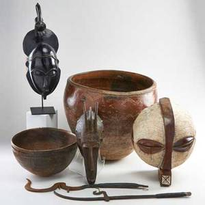 African decorative group seven pieces 20th c west african redware bowl three wood masks carved wooden bowl and two iron copies of sword currency unmarked tallest 17
