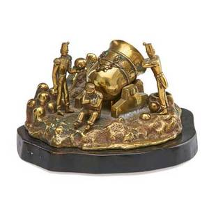 Continental figural inkwell patinated metal with soldiers and cannon on wood base 20th c 5 14 x 10 x 7