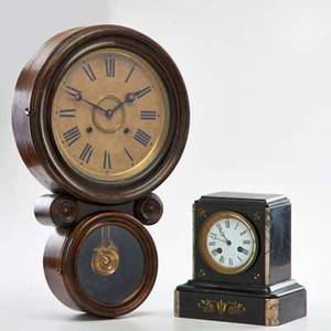 American clocks two late 19th c ingraham wall clock together with a j e caldwell  co marble mantle clock both marked taller 20