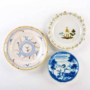 European faience three plates 18th19th c italian blue and white decorated with an infant and two french polychrome decorated blue and white marked largest 10 34 dia