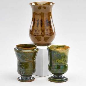 George ohr three small vases one with mottled green and ochre glazes one with mossy green glazes and one with green and brown glazes biloxi ms 18951900 all stamped tallest 4 14