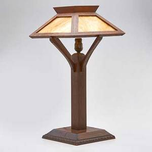 Arts and crafts table lamp with four panel caramel slag glass shade mounted to carved oak base usa ca 1915 unmarked 24 x 12 14 sq