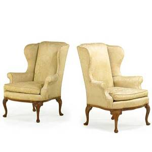 Pair of george ii style wing chairs walnut frames with enclosed padded back and loose cushion seat scroll carved cabriole legs on pad feet 20th c 44 12 x 36 x 24 12