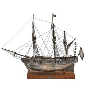 Silver replica of the hms bounty rigged with furled sails on wood base unmarked 12 x 15 34
