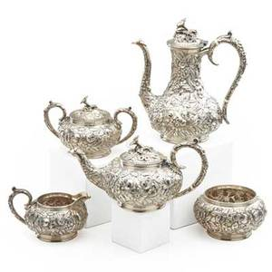 Samuel kirk  sons sterling silver tea and coffee service five items with floral repousse decoration early 20th c coffee pot tea pot sugar bowl cream jug and covered waste bowl 95 ot coffee p