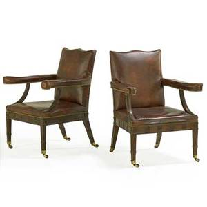 Pair of george iii style library armchairs mahogany with padded back and seat on square tapered legs ending in casters late 19th c 41 x 23 x 27