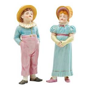 Pair of royal worcester porcelain figural sugar casters a boy and girl in 19th c dress early 20th c marked 7