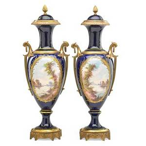 Pair of sevres porcelain bronze mounted covered urns reserves with courting couples and landscapes gilt borders ca 1900 marked 20