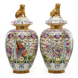 Pair of samson volkstedt porcelain covered urns strapwork and grotesque masks with bird and floral decorated panels and lion finials early 20th c marked 23