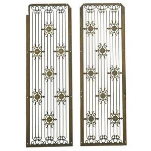Architectural pair of grilles from the singer building new york ca 1908 enameled wrought and gilt iron unmarked 54 12 x 17 12