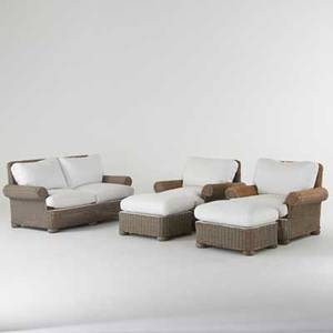 Contemporary wicker wicker loveseat pair of armchairs and ottomans with white cotton canvas upholstery 2000s unmarked loveseat 33 x 61 12 x 31