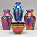 Zellique studio four glass pieces benecia ca 1993 two balustershaped vases with oil spot and millefiore design one balustershaped vase with cobalt oil spot and abstract figure design and one o