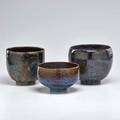 Edwin and mary scheier three stoneware pieces bowl coupe with incised figures and coupe in dark brown glaze usa second half 20th c all signed coupe with figures 6 x 6 34 dia