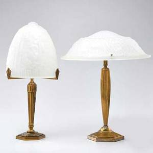 Art deco style two brass table lamps with frosted glass shades each molded with decorative motifs 20th c one with retailer label larger 18 34 x 15 34 dia