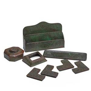 Tiffany studios eight piece assembled desk set pieces in zodiac pattern letterholder pen tray inkwell blotter corners calendar frame new york 1920s patinated bronze glass each stamped tiff