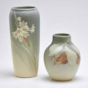 Weller two hudson light vases one decorated with paper whites and one with leaves and berries zanesville oh early 1920s to mid1930s both stamped weller taller 10 12
