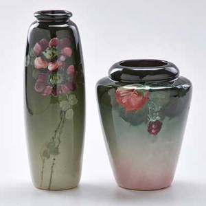 Weller two eocean vases one with wild roses and one with grapes and leaves zanesville oh late 19thearly 20th c taller stamped weller other inscribed eoean wellerx522 taller 10 14