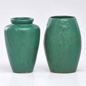 Art pottery two matte green vases with floral and leaf decoration first half of 20th c both unmarked taller 8 34