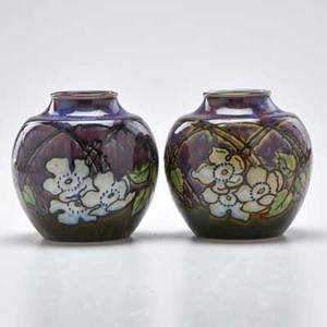 Royal doulton pair of bulbous vases in purple and dark green glazes decorated with wild white roses england 19021922 both have impressed mark each 5 34 x 4 12 dia provenance victoria an